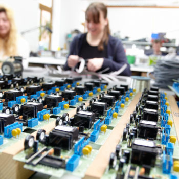 women populating electronic assemblies